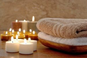 Massage towels and candles in a day spa