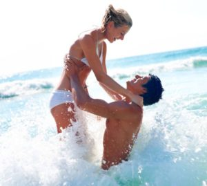 Couple on the Sunshine Coast in the surf