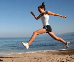 Woman running along beach