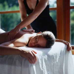 Woman on white massage table