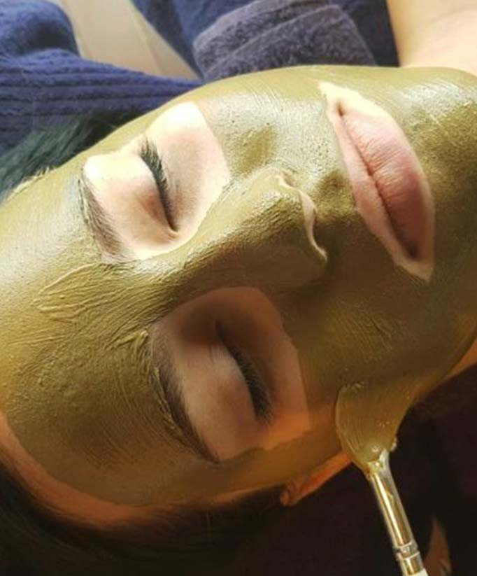 Facial being applied to client