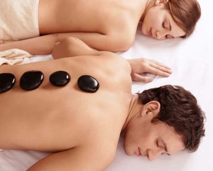 Couple having hot stone massages