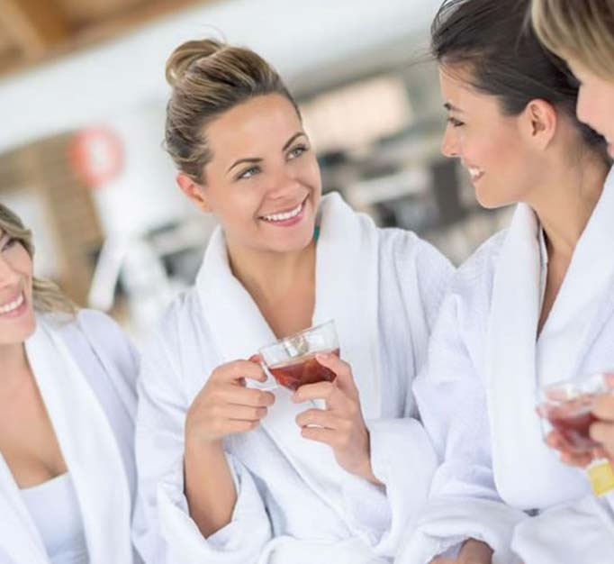 Girls at day spa for pamper treatments drinking tea