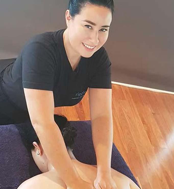 Massage therapist doing a massage at Ripple