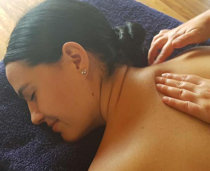 Massage therapist giving a relaxation massage