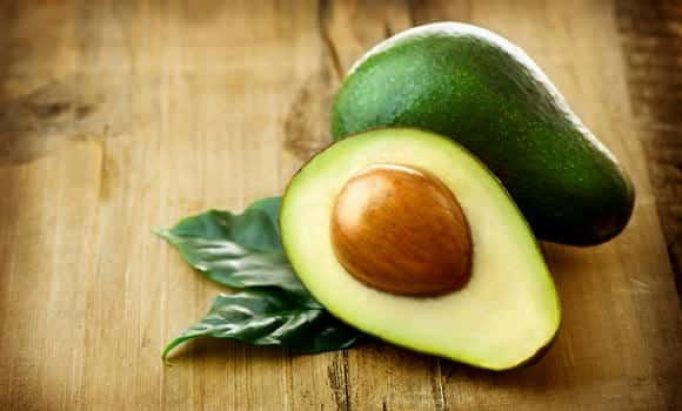 Cut avocado with seed and skin