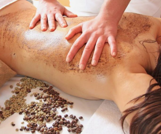 Coffee exfoliation on womans back