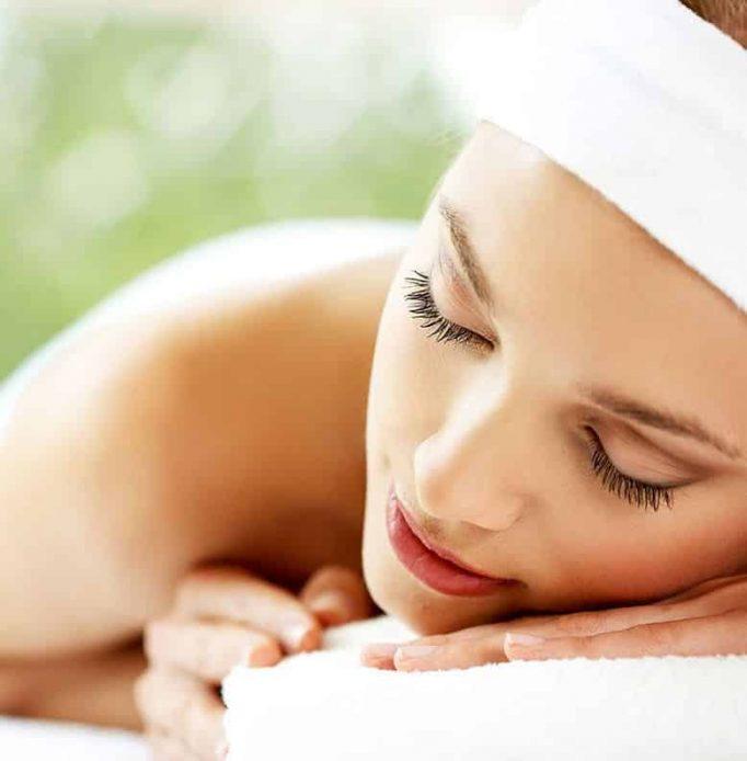 Woman having massage with white headband