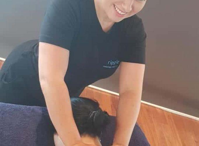 Ripple massage therapist doing an in home massage