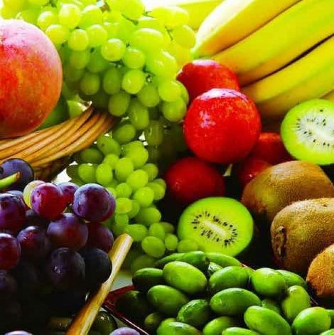 Selection of healthy foods including kiwi, strawberry, banana and grapes