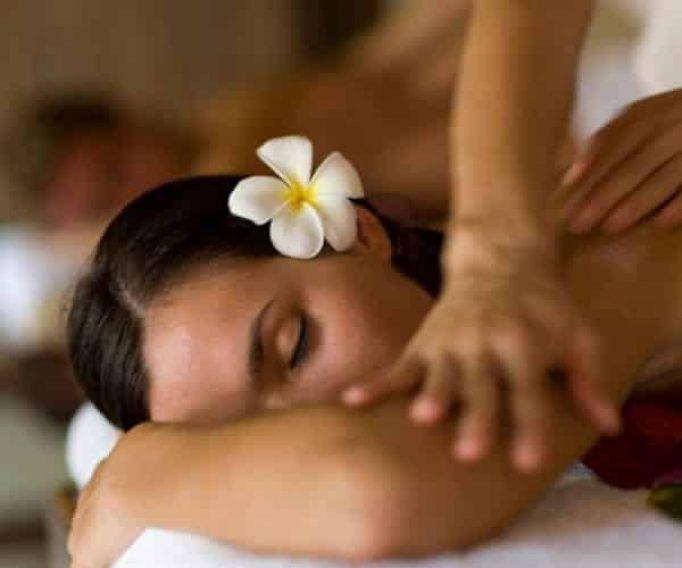 Massage therapist massaging a womans arm