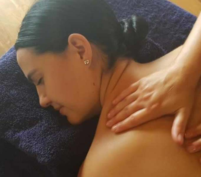 Woman having a relaxation massage for woman on blue towels