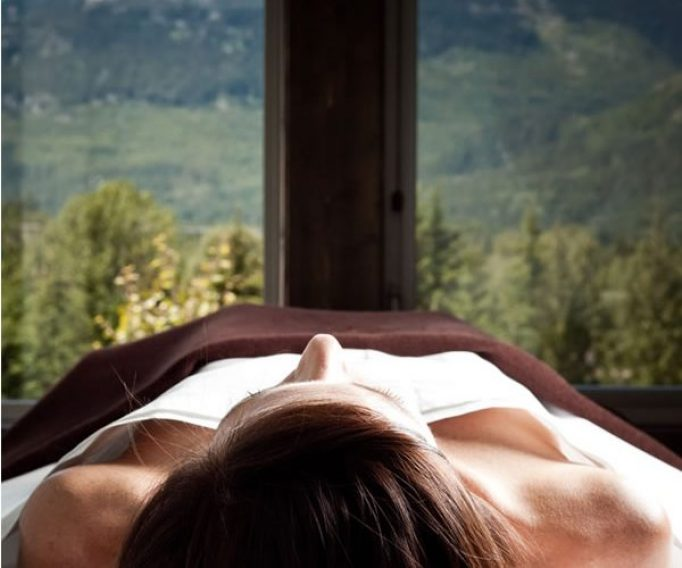 Woman lying face up on massage table