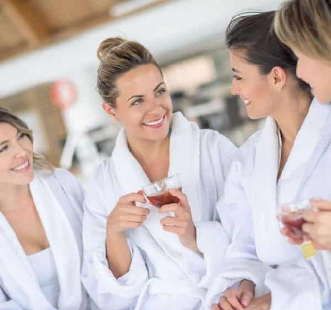 Women on a girls weekend drinking tea