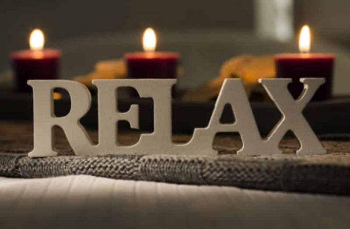The word Relax and candles in a day spa