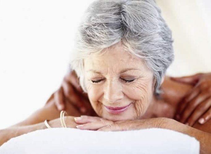 Massage of elderly woman in nursing home